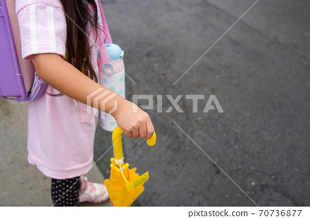 Elementary school girl (copy space) who goes to school with an umbrella 70736877