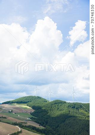 Beautiful mountain landscape, blue sky over hillside meadow 002 70746330