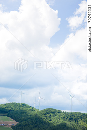 Beautiful mountain landscape, blue sky over hillside meadow 007 70746335