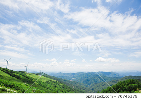 Beautiful mountain landscape, blue sky over hillside meadow 046 70746379