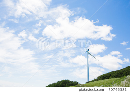 Beautiful mountain landscape, blue sky over hillside meadow 049 70746381