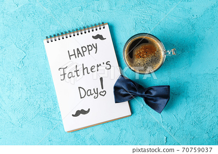 Notebook with inscription happy fathers day, blue bow tie and cu 70759037