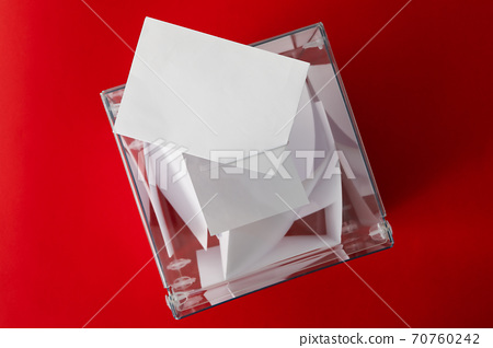 Voting box with bulletins on red background, top view 70760242