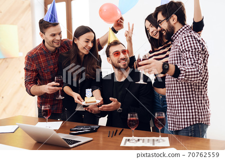 A group of office employees celebrate.  70762559