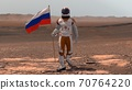 Astronaut walking on Mars with Russian flag. 70764220