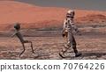 Martian sneaks behind an astronaut on Mars. 70764226