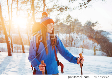 Woman Traveler with backpack hiking Travel Lifestyle adventure concept active vacations outdoor. Beautiful landscape forest 70775952