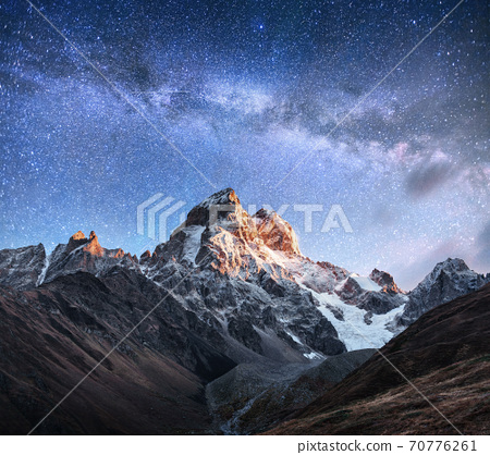Fantastic starry sky. Autumn landscape and snow-capped peaks. Main Caucasian Ridge. Mountain View from Mount Ushba Meyer, Georgia. Europe 70776261