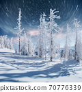 starry sky in winter snowy night. fantastic milky way in the New Year's Eve. In anticipation of the holiday. Dramatic scene. Carpathian. Ukraine 70776339