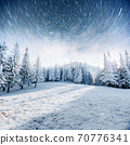 Dairy Star Trek in the winter woods. Dramatic and picturesque scene. In anticipation of the holiday. 70776341