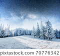Dairy Star Trek in the winter woods. Dramatic and picturesque scene. In anticipation of the holiday. 70776342