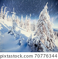 starry sky in winter snowy night. fantastic milky way in the New Year's Eve. In anticipation of the holiday. Dramatic scene. Carpathian. Ukraine 70776344
