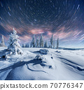 starry sky in winter snowy night. fantastic milky way in the New Year's Eve. In anticipation of the holiday. Dramatic scene. Carpathian. Ukraine 70776347