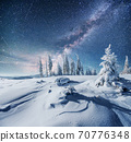 Dairy Star Trek in the winter woods. Dramatic and picturesque scene. In anticipation of the holiday. 70776348