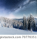 Dairy Star Trek in the winter woods. Dramatic and picturesque scene. In anticipation of the holiday. 70776351