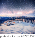 chalets in the mountains at night under the stars. Magic event in frosty day. In anticipation of the holiday. Dramatic scenes 70776352