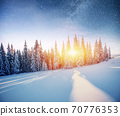 Dairy Star Trek in the winter woods. Dramatic and picturesque scene. In anticipation of the holiday. 70776353
