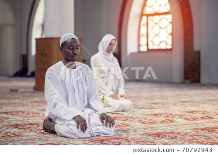 African Muslim Couple Praying inside of beutiful mosque 70792943