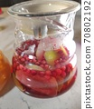 cranberry compote in a glass jug close-up 70802192
