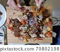 Ready fried chicken cut into pieces on a wooden Board 70802198