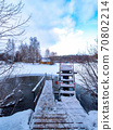 Stairs for swimming in an ice hole on the lake after a sauna on a cold day. 70802214