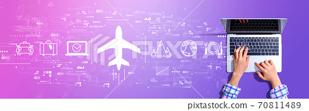 Flight ticket booking concept with woman using a laptop 70811489