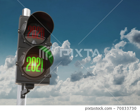 Traffic light with green light 2021 and red 2020 on sky background. Start New 2021 Year concept. 70833730