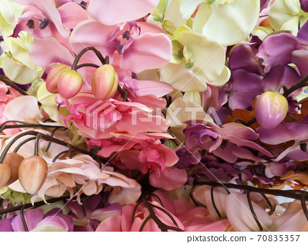 fake plastic flowers colored and decorative 70835357