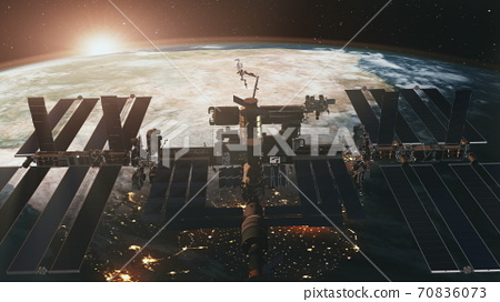 International Space Station at Earth sunset in 3d animation. Spatial orbit ISS fly in zero gravity 70836073