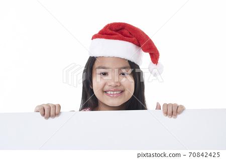 Happy little girl holding a blank board 70842425