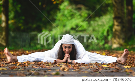 Yoga posture on the ground on the autumn leaves 70846076