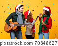 Happy diverse friends having party singing and celebrating Christmas 70848627