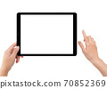Isolated human left hand holding black tablet computer 70852369