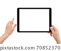 Isolated human right hand holding black tablet computer 70852370