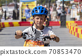 Child drives an electric car. Go-karts for children. 70853470