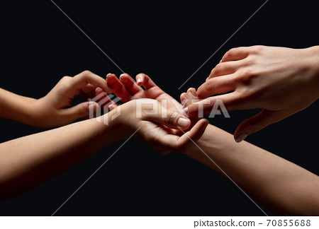 Hands of people's crowd in touch isolated on black studio background. Concept of human relation, community, togetherness, symbolism 70855688