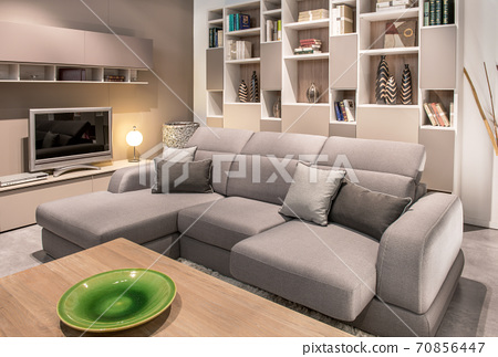 Large comfortable beige sofa in a living room 70856447