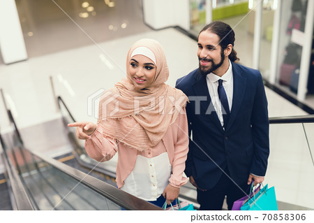 Young Arabian Couple Shopping in Modern Mall. 70858306