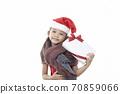 Child holding Christmas gift box 70859066