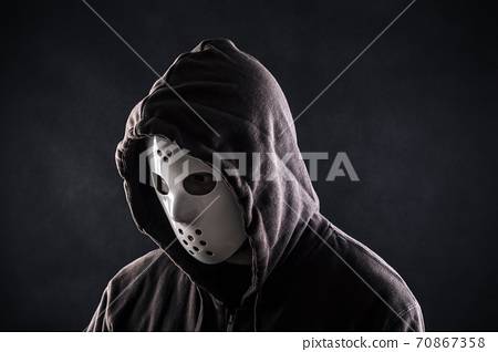 Hooded maniac or criminal in mask 70867358