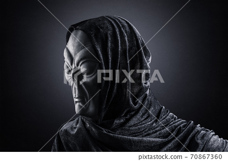 Portrait of a scary humanoid alien in the dark 70867360