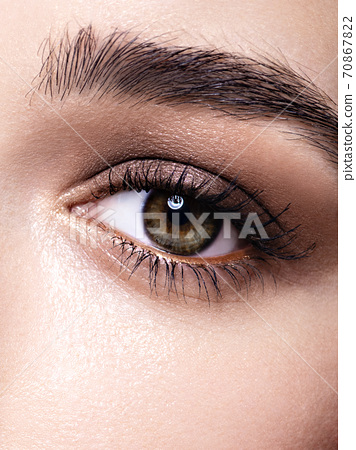 A young woman eye with smokey eyes makeup. 70867822