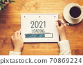 Loading new year 2021 with a person holding a pen 70869224