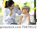 Asian senior woman listen,study how to use dental floss with professional female dentist,service or educate about oral health care,gums treat,teach teeth cleaning hygiene while visiting a nursing home 70878522