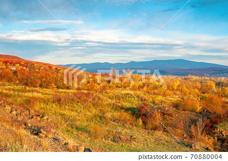rural valley at sunset. beautiful autumn landscape in mountains. village in the distant valley. clouds on the blue evening sky 70880004