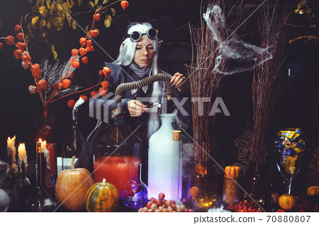 Halloween elf with magic magic in the dark forest. 70880807