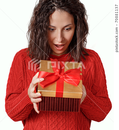 Surprised young woman opening Gift box close up 70881137