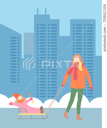 Mother pulling child on sleds, happy family leisure outdoors, urban view background 70882109