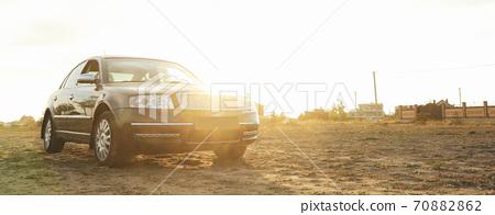 Black sedan car against sunlight, space for text 70882862