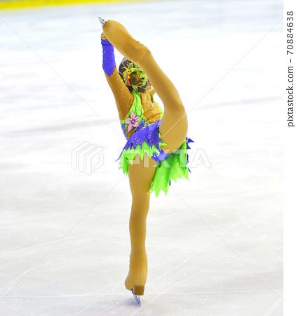 Girl figure skating 70884638